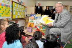 Supervisor Knabe reads a book to children at Mayne Street Preschool in Bellflower