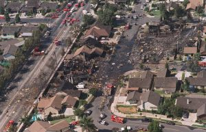 A black path runs through the Cerritos, Calif., neighborhood in this August 31, 1986 file photo, after a midair collision between an AeroMexico DC-9 and a small twin-engine plane. The crash of Aeromexico Flight 498 killed 82 people: 64 jetliner passengers, 15 people on the ground and three in the small plane that collided with the jet as it approached Los Angeles International Airport. In terms of victims on the ground, it was the nation's worst air accident.(AP Photo/Lennox McLendon)